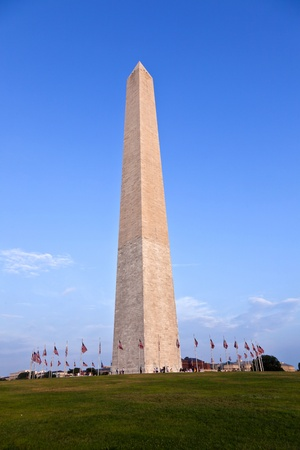 historical landmark: Outdoor view of Washington Monument in Washington DC with beautiful blue sky in background
