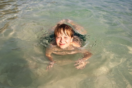 rote: boy has fun in the wonderful warm ocean and enjoys the water