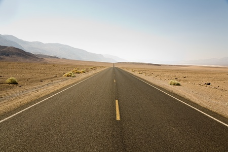 driving on the Interstate 187 in Death valley direction Badwater in the heat of the Mojave Desert photo