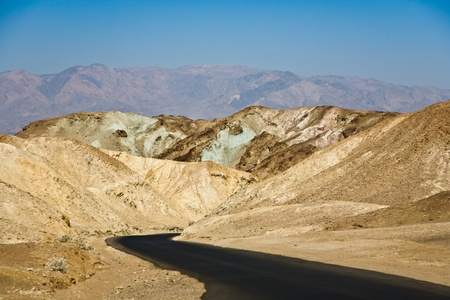 scenic road Artists Drive in Death valley, arount stones,hills  with colorful minerals, blinking colorful in the sun photo