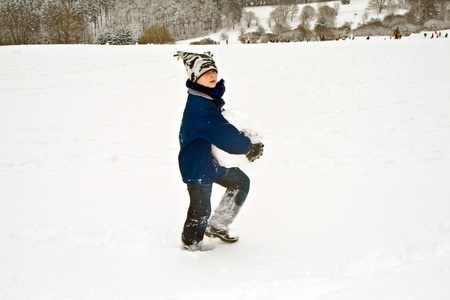 children are sledding down the hill in snow, white winter Stock Photo - 9396008