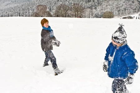 children in a snowball fight photo