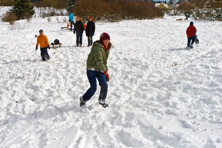 children have a snowball fight in the white beautiful snowy area photo