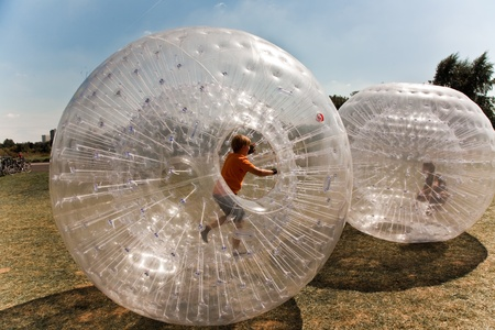 children have a lot of fun in the Zorbing Ball Stock Photo - 9400362