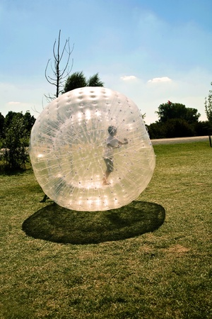 child has a lot of fun in the Zorbing Ball photo