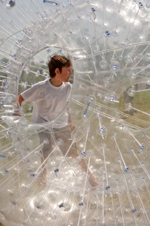 children have a lot of fun in the Zorbing Ball Stock Photo - 9398708