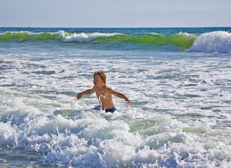 boy plays at the beautiful beach in California Stock Photo - 9392621