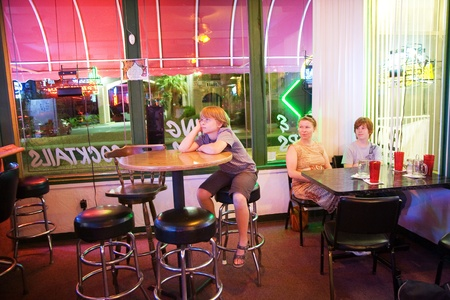 barstool: family in a bar and Pizzeria watching TV