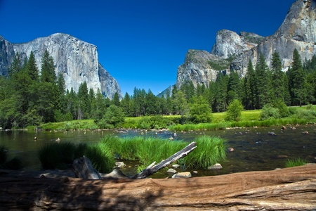 view to western rocket plateau of yosemite national park seen from beautiful Merced river Stock Photo - 9392689