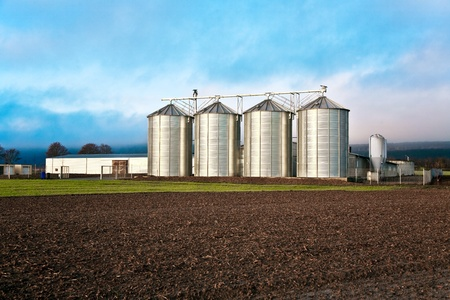 Silo in beautiful landscape placed in ploughed fields photo