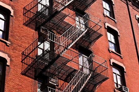 stucco facade: fire ladder at old houses downtown in New York