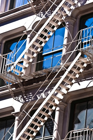 fire ladder at old houses downtown in New York Stock Photo - 9400216