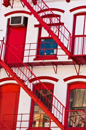 stucco house: fire ladder at old houses downtown in New York