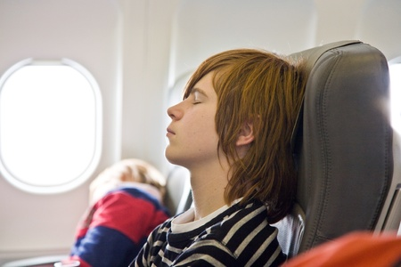 boy sleeping in the aircraft Stock Photo - 9469268