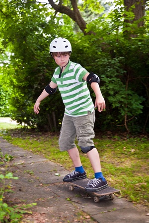 young boy on his skate board photo