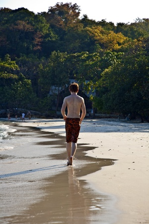 young boy running at the beautiful beach Stock Photo - 9583347