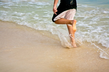 feet on the beautiful sandy beach Stock Photo - 9583322