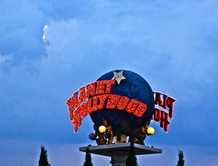 sinners: LAS VEGAS - JULY 17: The  Planet Hollywood globe  on the Las Vegas Strip in the late afternoon in neon light on  July 17, 2008 in Las Vegas, USA. Editorial