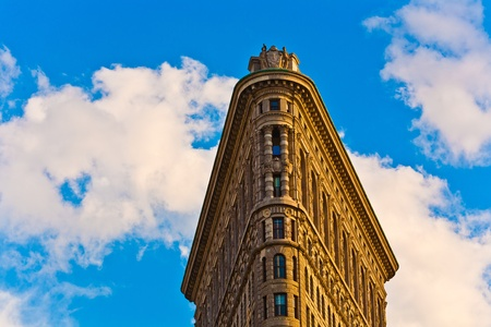 NEW YORK, USA - JULY 12: Facade of the Flatrion building  with iron statue of Man on the roof sun on July 12,2010 in New York, USA. Stock Photo - 9475203