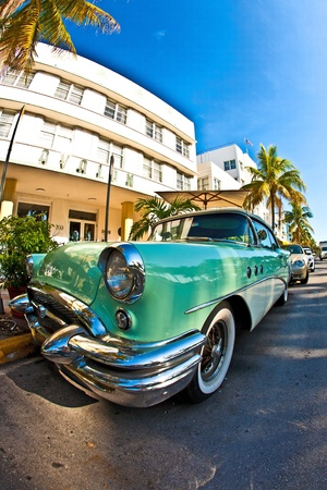 MIAMI BEACH, USA - AUGUST 02: The emblematic architecture of the Art Deco Era of Hotel Avalon  and the signature 1950's Oldsmobile in front, sets the tone for south beach experience on August 02,2010 in Miami Beach.