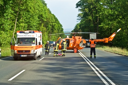 BAD HOMBURG, GERMANY - May 05: Helicopter on the street to save and transport a seriously insured person by car accident to hospital, May 05,2007, Bad Homburg, Germany