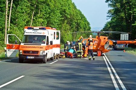 bad accident: BAD HOMBURG, GERMANY - May 05: Helicopter on the street to save and transport a seriously insured person by car accident to hospital, May 05,2007, Bad Homburg, Germany