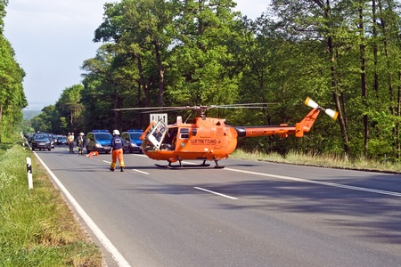 BAD HOMBURG, GERMANY - May 05: Helicopter is landing on the street to save and transport a seriously insured person by car accident to hospital, May 05,2007, Bad Homburg, Germany Stock Photo - 9500858
