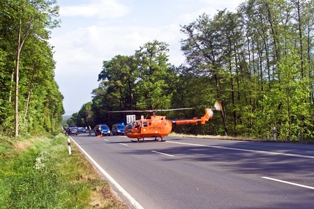 BAD HOMBURG, GERMANY - May 05: Helicopter is landing on the street to save and transport a seriously insured person by car accident to hospital, May 05,2007, Bad Homburg, Germany