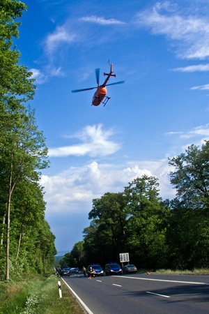 BAD HOMBURG, GERMANY - May 05: Helicopter is landing on the street to save and transport a seriously insured person by car accident to hospital on May 05,2007, Bad Homburg, Germany