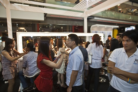 BANGKOK, THAILAND - May 11: cosmetic company AMWAY sponsores a makeup course with its products in the central world center and assists woman in using products , May 11, 2009 in Bangkok, Thailand