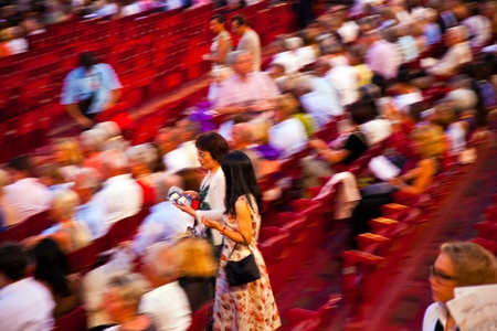 VERONA, ITALY - August 05: beautiful dressed people are searching their chairs in the famous opera of Verona  August 05,2009, Verona, Italy. Stock Photo - 9500708