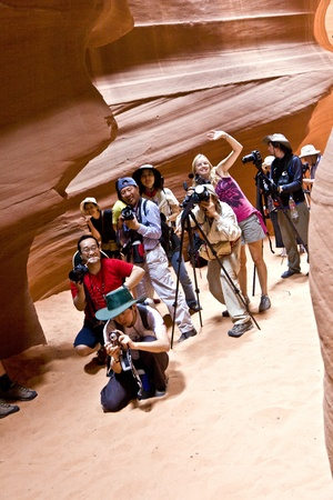 PAGE, USA JULY 07: Photographers hace a workshop and taking pictures from the upper Antelope Canyon to catch the best light during Midday on July 07, 2008 in Page, USA.
