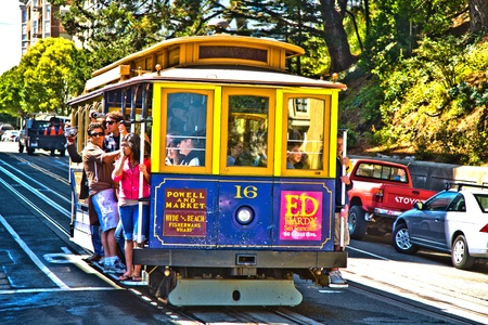 SAN FRANCISCO, USA - JULY 24:  The Cable Car passes the Powell street in rush hour full of passengers standing also on the footboard  on July 24,2008 in San Francisco, USA.