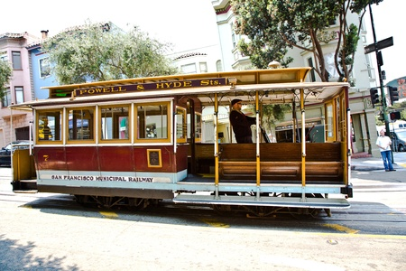 SAN FRANCISCO, USA - JULY 24:  The Cable Car passes the Powell street and the conductor prepares the car  for a new ride  on July 24,2008 in San Francisco, USA.