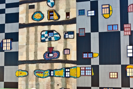 VIENNA, AUSTRIA - APRIL 25: Mosaic on the most famous District heating in Vienna of artist Hundertwasser in intensive afternoon light on April 25, 2009 in Vienna, Austria.