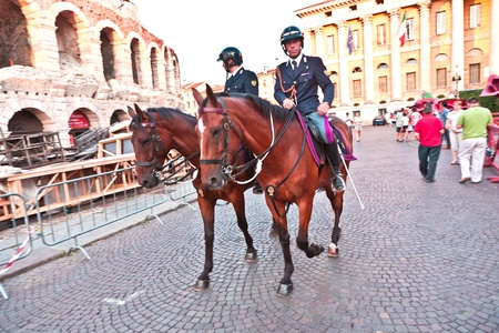 verdi: VERONA, ITALY - AUGUST 05: Police on horses are watching and helping the spectators entering the Arena di Verona for a Masterpiece of Verdi on  August 05,2009, Verona, Italy. Editorial