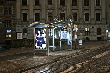 cobblestone street: VIENNA, AUSTRIA - DECEMBER 09: Vienna - empty bus stop in Viennas first district by night  on December 09, 2009 in Vienna, Austria.