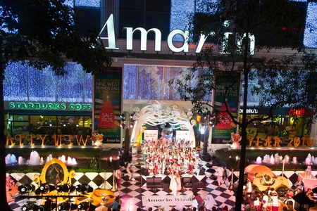 sponsoring: BANGKOK, THAILAND - DECEMBER 22: a chorus is singing christmas songs outside the shopping center Amarin on December 22, 2009 in Bangkok, Thailand. Amarin sponsors the show.