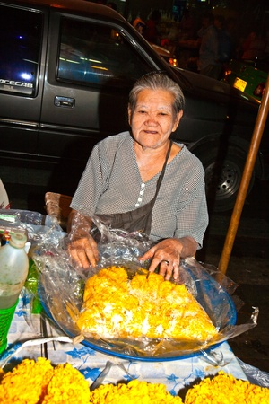 malai: BANGKOK, THAILAND - DECEMBER 23: people selling flowers at Pak Khlong Thalat market on December 23, 2009 in Bangkok, Thailand. The market was invented by King Rama in the late 18th century. Editorial