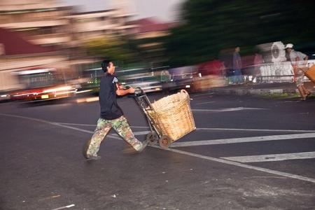 malai: BANGKOK, THAILAND - DECEMBER 23: people carrying their goods back home after joining the night market at Pak Khlong Thalat on December 23, 2009 in Bangkok, Thailand. Editorial