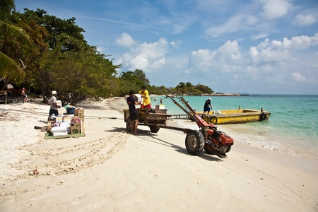 local supply: delivery of food to the resort by boat at the island of Koh Samet in Thailand at the 29th of Dec 2009.