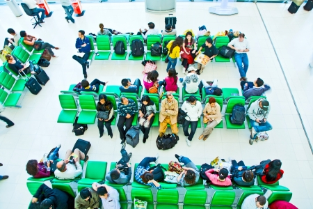 BANGKOK - DECEMBER 21: The human wait on benches for the departure of their flight at Suvarnabhumi International Airport on December 21, 2009 in Bangkok. The airport is 18th busiest in the world (by passenger traffic).