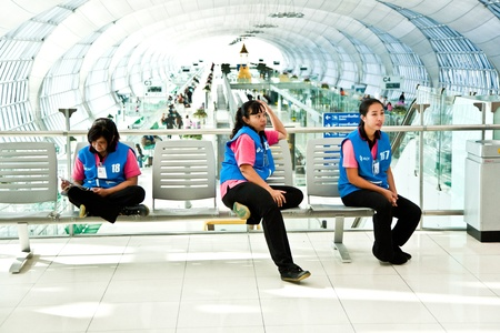 BANGKOK - JANUARY 05: Women of the cleaning company at new Airport Suvarnabhumi have a short rest before they continue working on January 05, 2010 in Bangkog, Thailand.