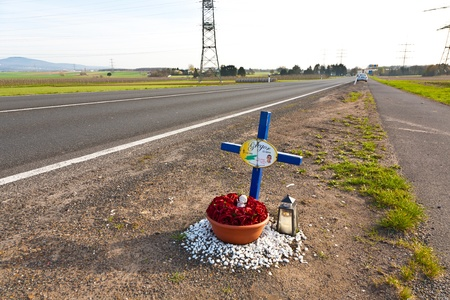 HOFHEIM, GERMANY - APRIL 7: A cross for the young man Gregor who died at that place in the year 2006 in a traffic accident in the age of 22. This cross  remembers people of the danger of traffic n April 07, 2010 in Hofheim, Germany.