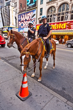 NEW YORK, USA - JULY 7: policeofficer is riding his horse downtown in New York, Manhattan on  July 7,2010, New York, USA Stock Photo - 9522299