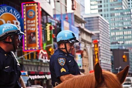 NEW YORK, USA - JULY 7: policeofficer is riding his horse downtown in New York, Manhattan on  July 7,2010, New York, USA