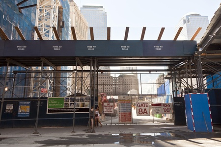 NEW YORK, USA - JULY 9: workers and gate for construction site on Ground Zero,rebuilding the site on July 9, 2010, New York