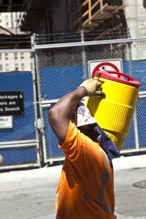 NEW YORK, USA - JULY 9: worker carries a ton with building material for construction work on Ground Zero,rebuilding the site on July 9, 2010, New York Stock Photo - 9522188