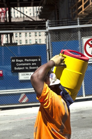 NEW YORK, USA - JULY 9: worker carries a ton with building material for construction work on Ground Zero,rebuilding the site on July 9, 2010, New York