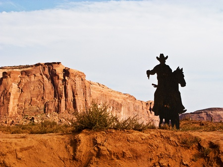 Cowboy on a Horse Silhouette in the Monument Valley Stock Photo - 9543945